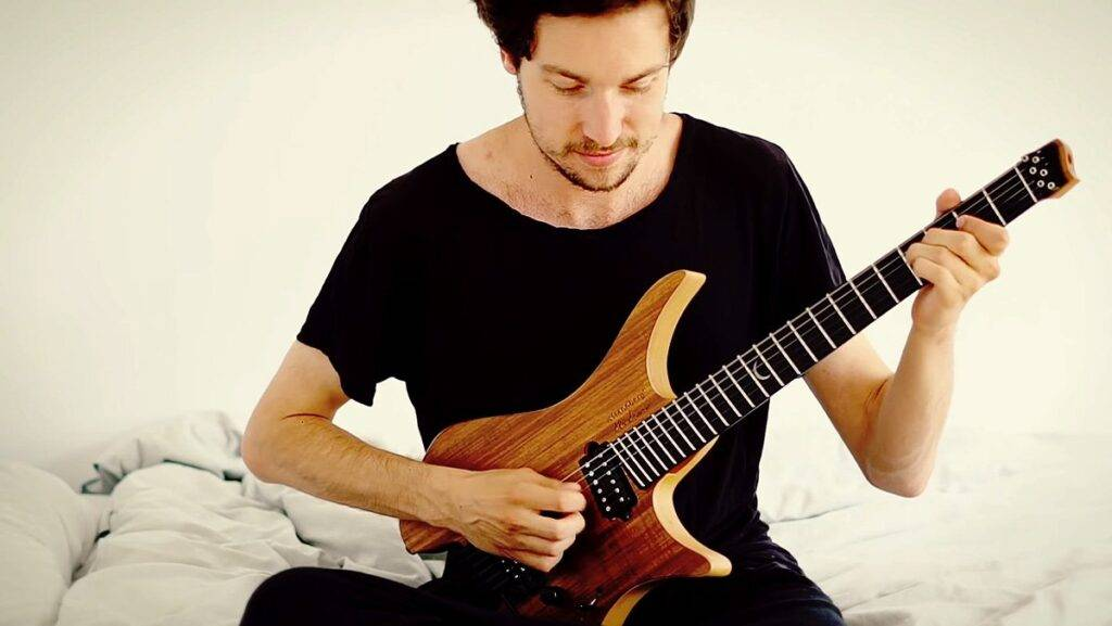 plini playing guitar